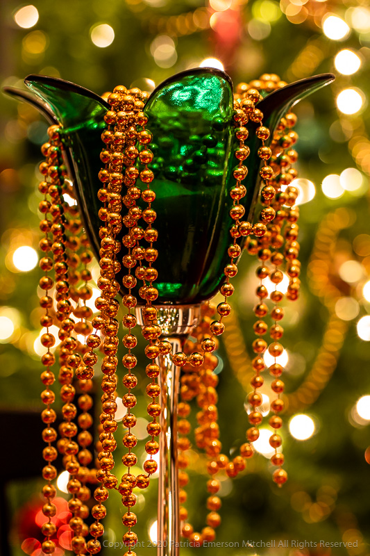 Beads in a green candle holder